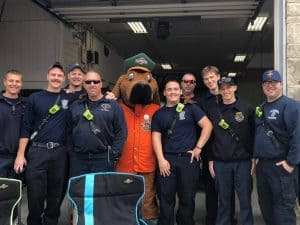 mascot with firemen